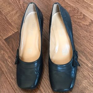 Heels are about 1 inch height, mint condition